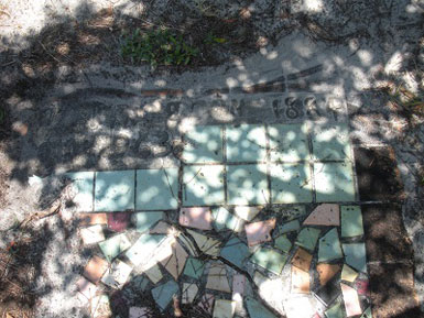 Grave marker with bright color tile mosaic