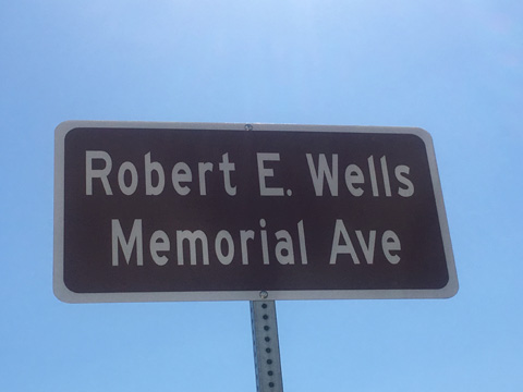 Robert E. Wells Memorial Avenue Sign