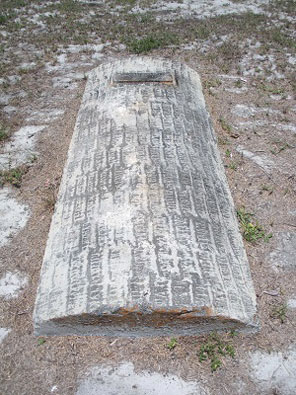 Grave with concrete slab